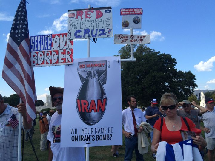 Tracey Anderson from Indianapolis stands to the right of signs opposing the Iran deal.