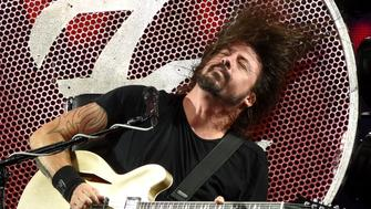 QUEBEC CITY, QC - JULY 11:  Dave Grohl of The Foo Fighters performs during a major rainstorm at the 2015 Festival D'ete De Quebec on July 11, 2015 in Quebec City, Canada.  (Photo by C Flanigan/WireImage)