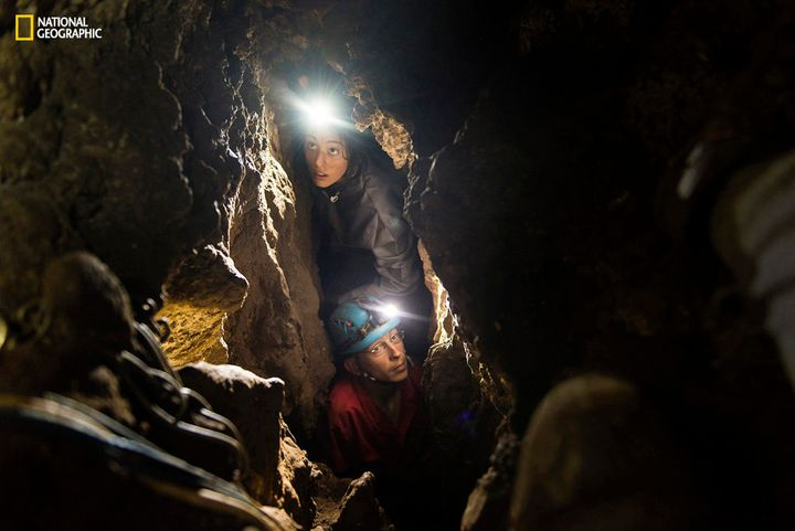 Lee Berger's daughter, Megan, acting as a safety caver on the expedition, and underground exploration team member Rick H