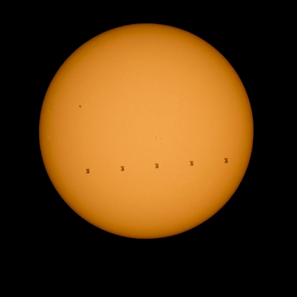<span>This NASA image shows the International Space Station silhouetted against the sun.&nbsp;</span>