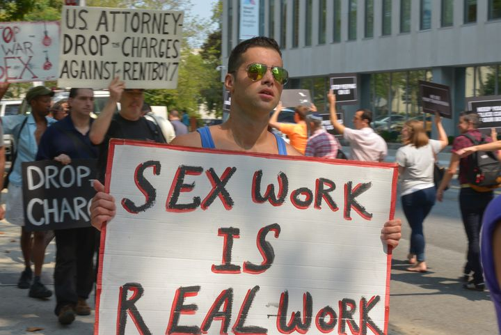A demonstrator protests the federal raid on Rentboy.com, a male escort site.