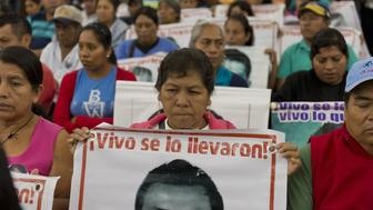 <p>Relatives and friends of the 43 missing Ayotzinapa students wait before the IACHR present the first conclusions of their investigation in Mexico City on Sept. 6, 2015.</p>