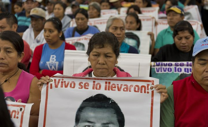 Relatives and friends of the 43 missing Ayotzinapa students wait before the IACHR present the first conclusions of their inve