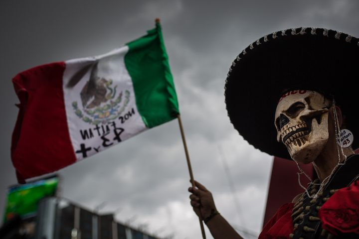 A protester marks 11 months since the disappearance of the 43 Ayotzinapa students in Mexico City, Aug. 26, 2015.