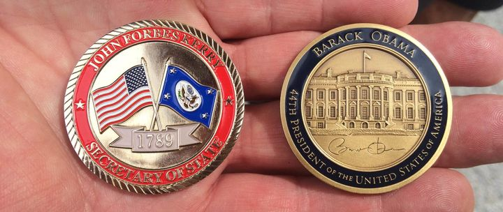 Secretary of State John Kerry and President Barack Obama's challenge coins.