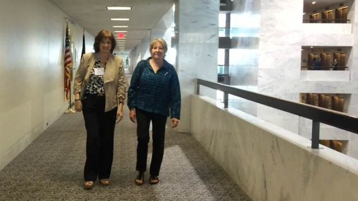 Karen Meredith and Michelle DeFord walk in the Hart Senate Office Building, where they talked with lawmakers about their supp