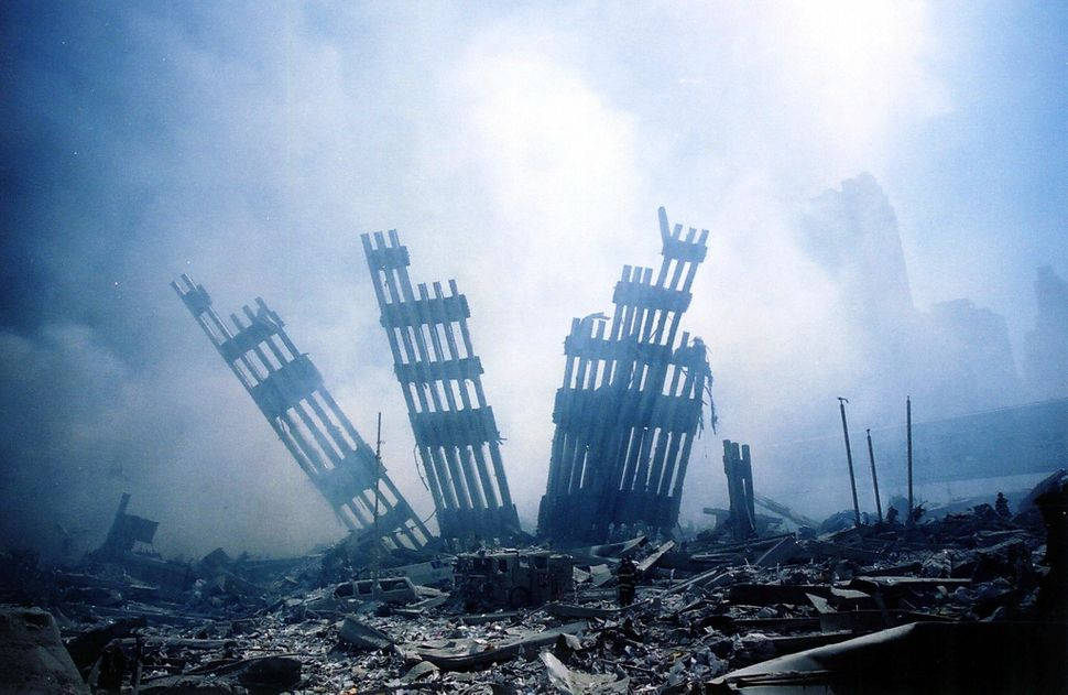 "<span style=""color: #222222;"">The rubble of the World Trade Center smolders.</span>"