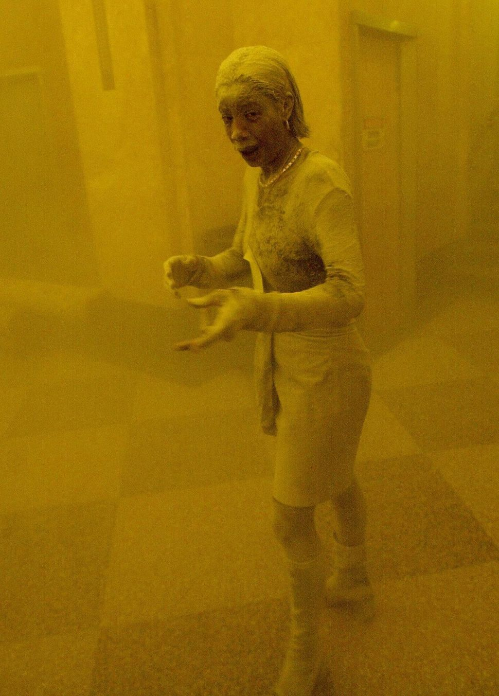 Marcy Borders is covered in dust as she takes refuge in an office building. Borders died in 2015 after a battle with can