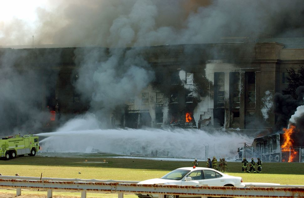 <span>Smoke and flames can be seen at the Pentagon shortly after a hijacked jetliner was crashed into the building in Washing