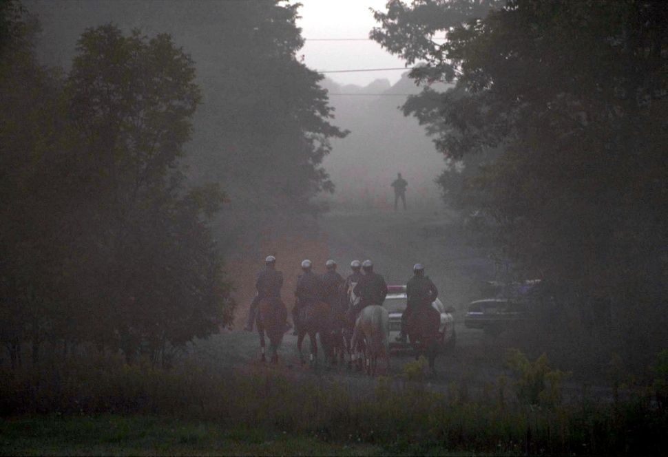 "<span style=""color: #222222;"">Mounted police make their way along an access road leading to the crash site of United Airlines"