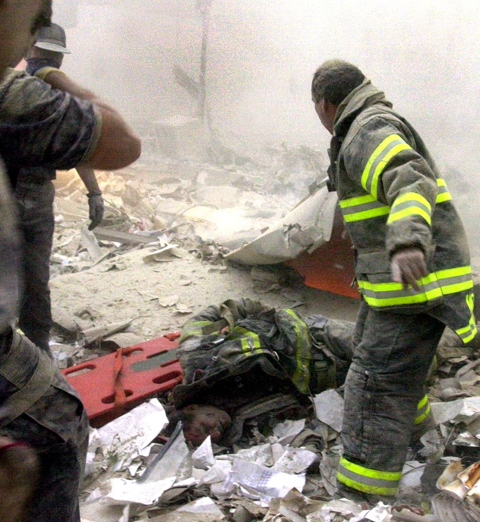 "<span style=""color: #222222;"">Firefighter Kevin Shea of Ladder 35 lies semi-conscious in a debris field with firefighter Ritc"