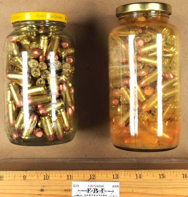 Jars of bullets collected from the scene.