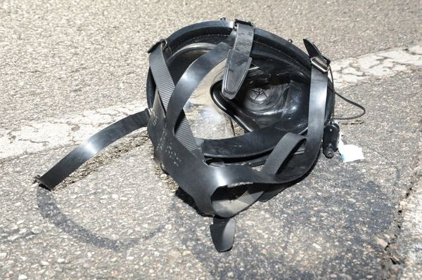 The gas mask used by Holmes lies in the Aurora movie theater parking lot.