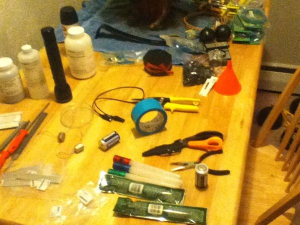 James Holmes' kitchen table cluttered with devices used to make bombs.