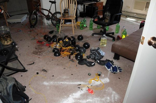 James Holmes' apartment was rigged to explode.