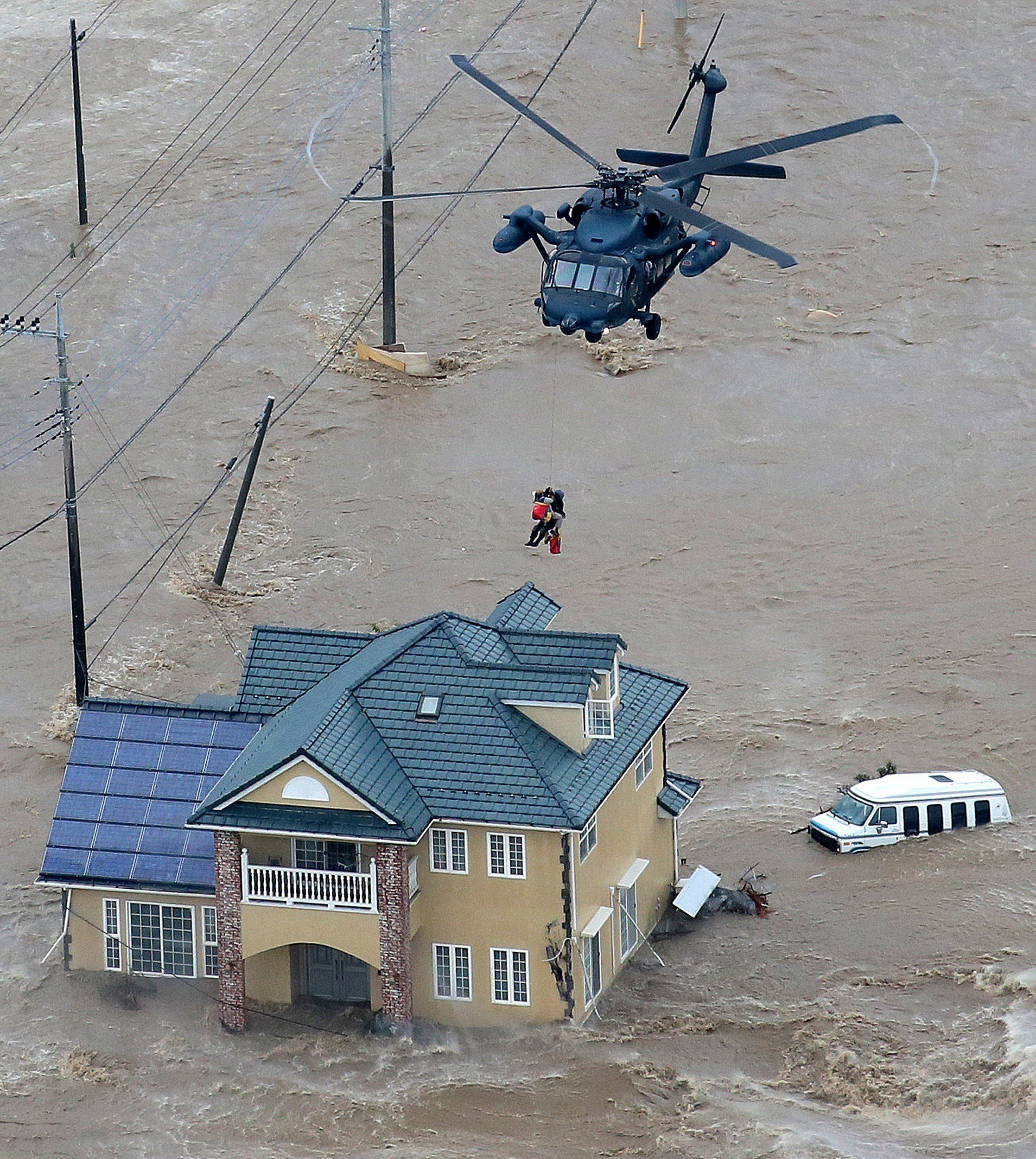 Local residents were rescued from their flooded home by a helicopter of the Ground Self Defence Force in Joso, Japan.