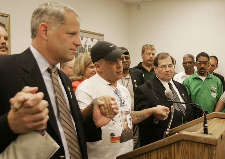 John Feal is flanked by Rep Steve J. Israel (D-NY) (L) and Rep. Jerrold Nadler (D-NY) (C) talks about his injuries during a n