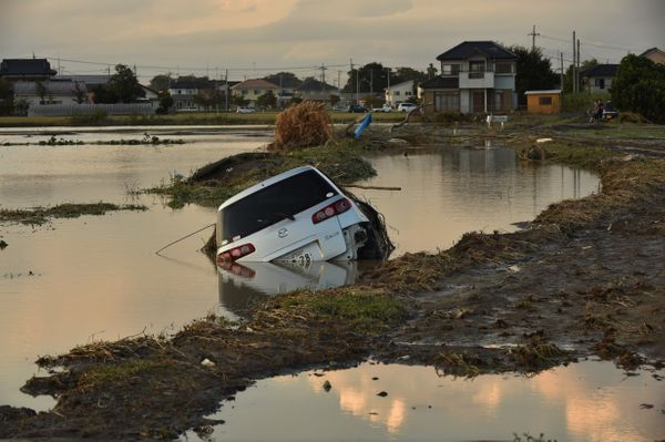 A vehicle is submerged in a flooded paddy field in Joso, Japan, on Sept. 11, 2015.