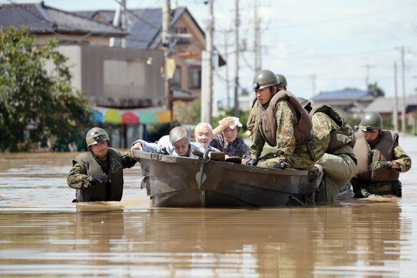 Japan's Self-Defense Force evacuate elderly people in a boat in Joso, Japan, on Sept. 11, 2015.