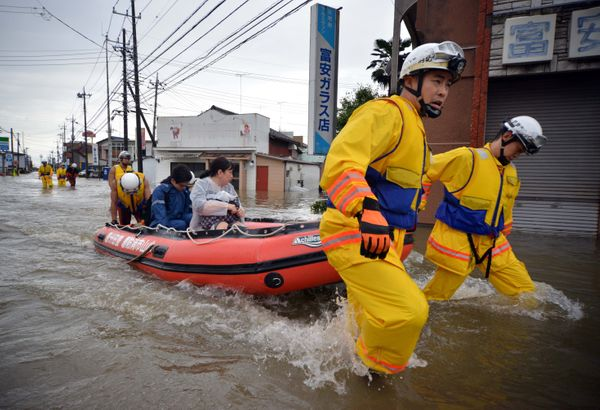 Rescue workers transport evacuees in a rubber boat through floodwaters at Oyama in Tochigi prefecture, near the Ibaraki prefe