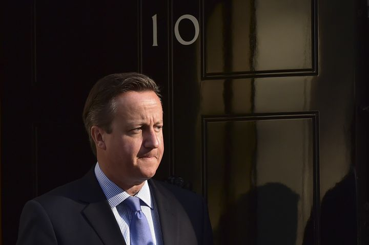 Britain's Prime Minister David Cameron outside 10 Downing Street ahead of a meeting in London on September 10, 2015.