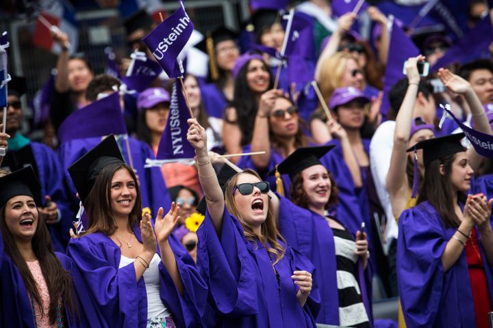 New York University students at their graduation ceremony in May 2014. The school's low-income students take on more federal