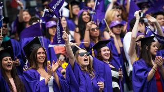 NEW YORK, NY - MAY 21:  Students celebrate at the commencement of the 2014 New York University graduation ceremony at Yankee Stadium on May 21, 2014 in the Bronx borough of New York City. Janet Yellen, Chair of the Board of Governors of the Federal Reserve System, received an honorary doctorate and was the 2014 commencement speaker.  (Photo by Andrew Burton/Getty Images)