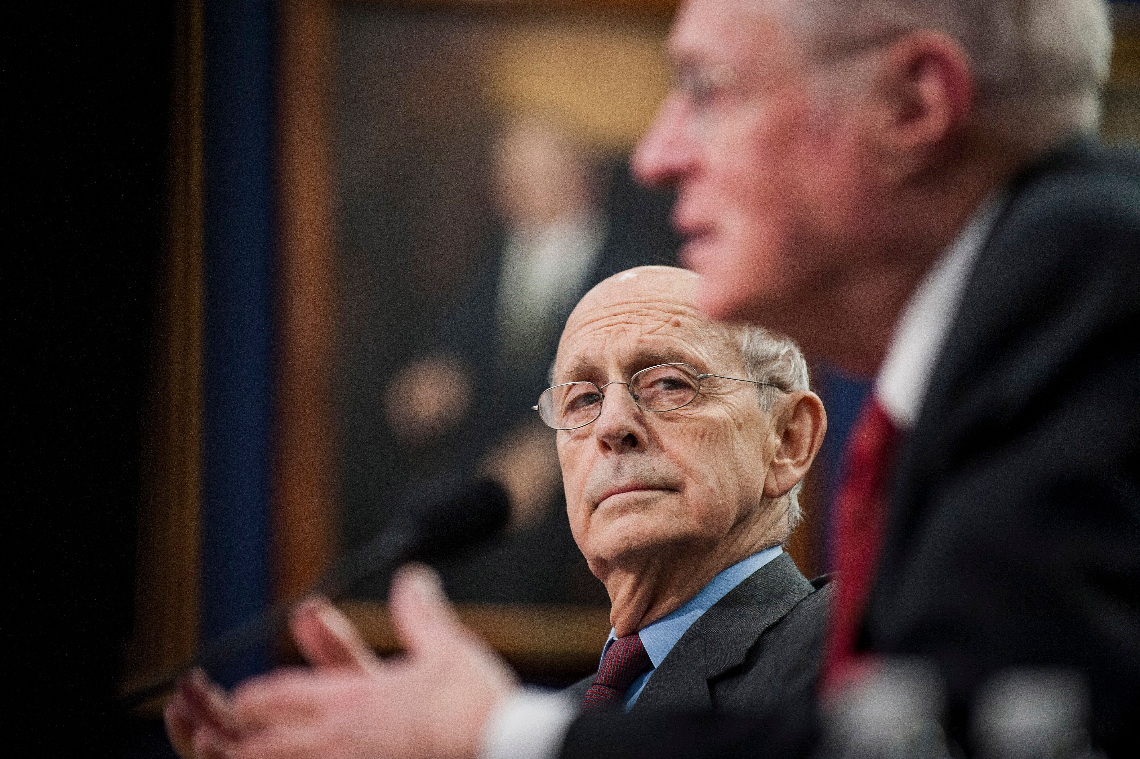U.S. Supreme Court Justices Stephen Breyer, left, and Anthony Kennedy testify during a Financial Services and General Government Subcommittee in Washington, D.C., U.S., on Monday, March 23, 2015. Sprinting toward their spring recess, the House and Senate will separately consider budget blueprints, perhaps leading to the first joint congressional budget in six years. Photographer: Pete Marovich/Bloomberg via Getty Images