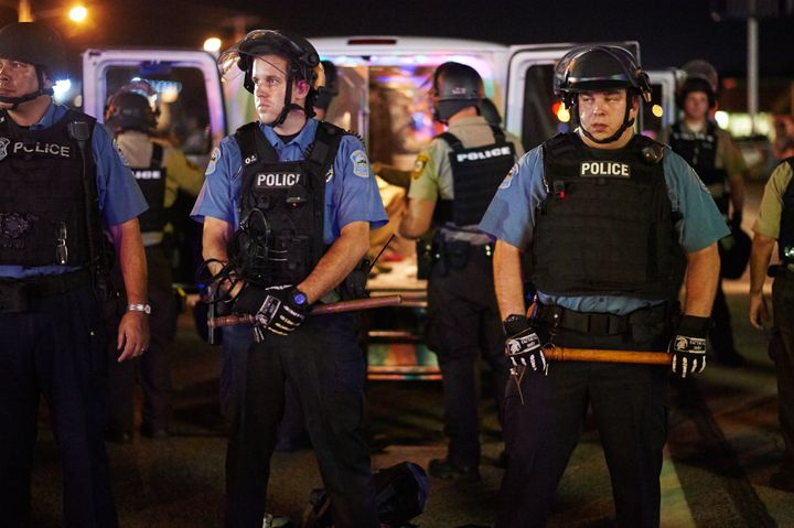Police deployed during a civil disobedience action on August 10, 2015 on West Florissant Avenue in Ferguson, Missouri. The ni