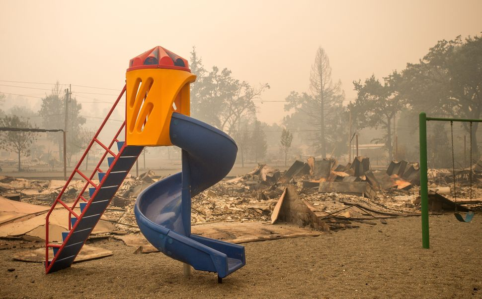 A playground is surrounded by smoldering rubble in Middletown, California, Sept. 13, 2015.