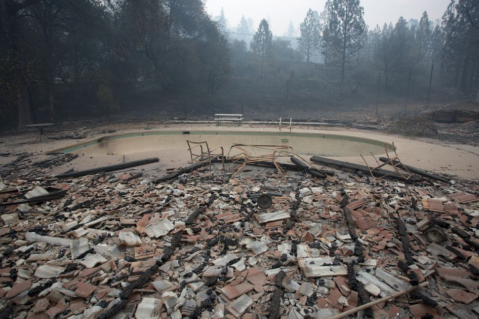 Structures around a pool lie in ruins after the wildfire destroyed the Golden Spur mini market north of Murphys, ne