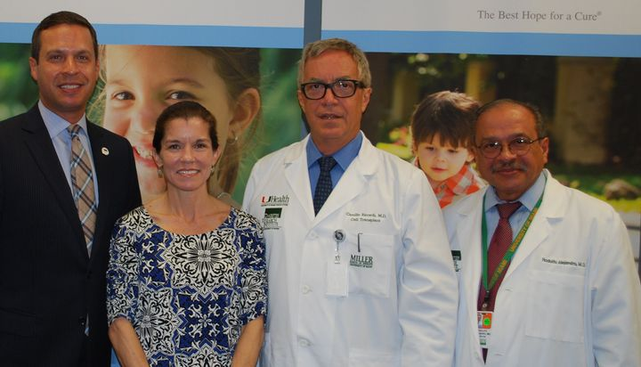 Pictured from left to right: DRI Foundation President and CEO Joshua Rednik, transplant patient Wendy Peacock, and Drs. Camillo Ricordi and Rodolfo Alejandro.
