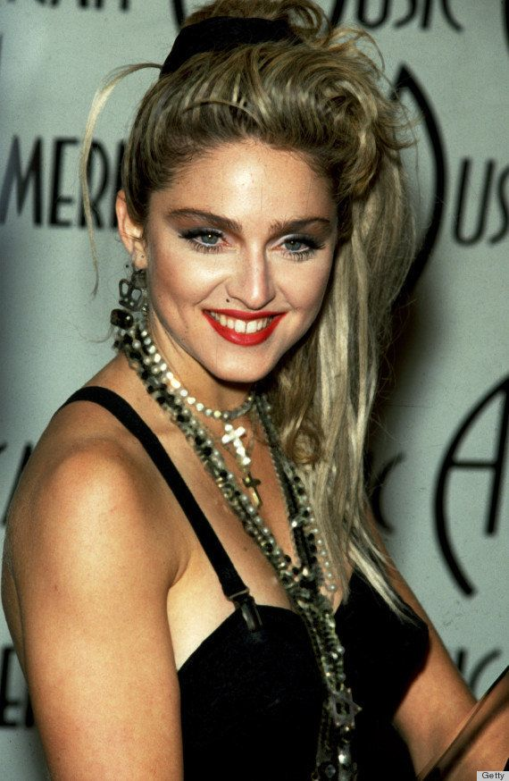 """During her """"Like a Virgin"""" phase, Madonna's shockingly red lips added an ironic twist to her naughty Catholic look."""