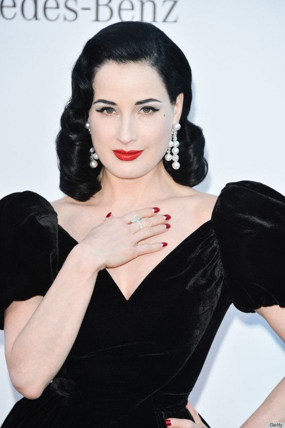 The queen of gothic glam is almost never seen without deep red lipstick to complete her look.