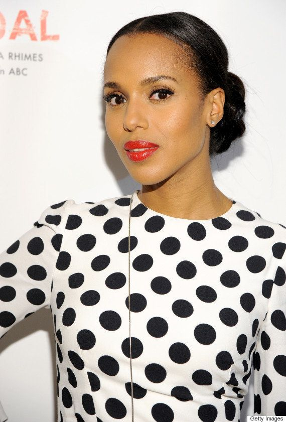 Oozing classic glamour, Washington's high-sheen red lips add a pop of color to her outfit.