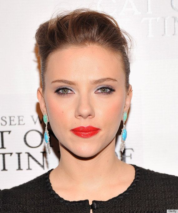 ScarJo looks stunning in bright red lipstick whether she's a brunette, blonde or redhead.
