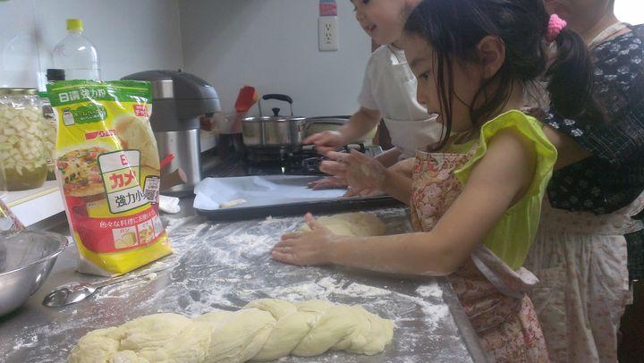 Melissa Uchiyama's children braid challah bread with their grandmother in Tokyo.