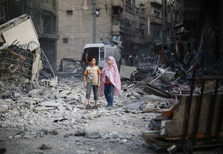 People are seen after Assad regime forces' air-strike staged to residential areas, in Douma District of East Ghouta region of