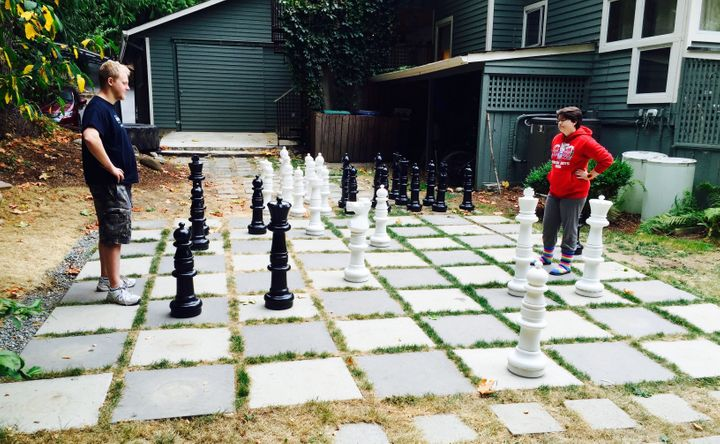 Chloe Mason faces off with Tom, a fellow client, in a game of chess at the reSTART Center.