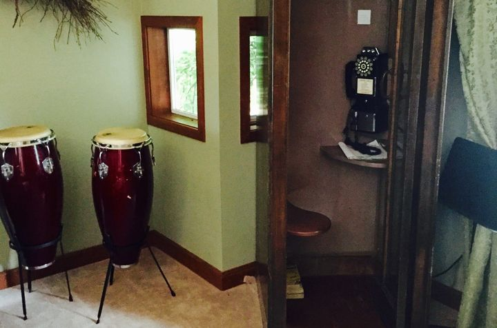 An old-fashioned telephone booth replaces cell phones at reSTART, where clients can also try their hand at various musical instruments.