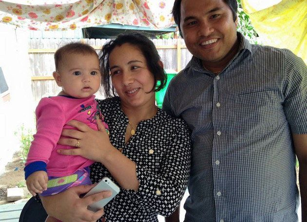 Som Nath Subedi with his wife and daughter.