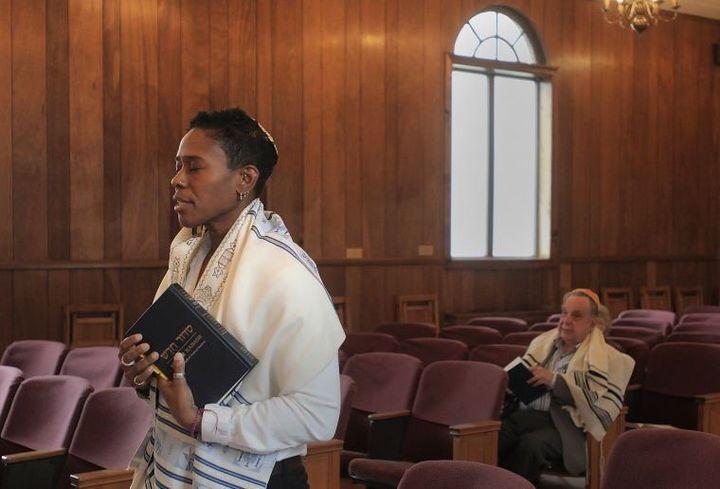 Sandra Lawson prays at the Bristol Jewish Center.