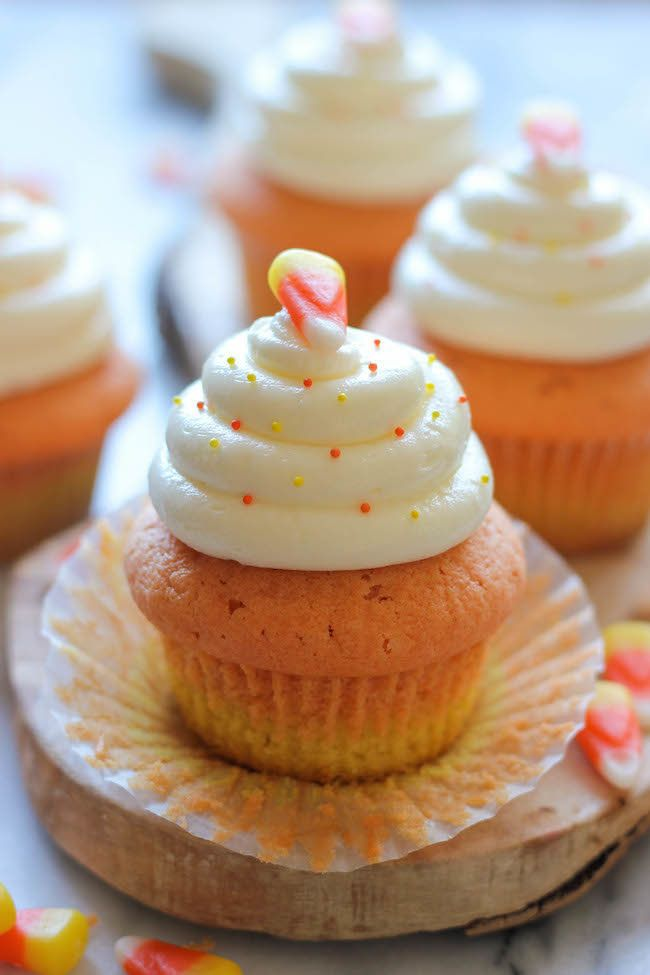 "<strong>Get the <a href=""http://damndelicious.net/2013/10/28/candy-corn-cupcakes/"" target=""_blank"">Candy Corn Cupcakes recipe"