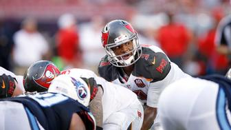 TAMPA, FL - SEPTEMBER 13: Jameis Winston #3 of the Tampa Bay Buccaneers gets ready to take the snap against the Tennessee Titans at Raymond James Stadium on September 13, 2015 in Tampa, Florida. The Titans defeated the Bucs 42-14. (Photo by Joe Robbins/Getty Images)