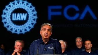 Fiat Chrysler Automobiles CEO Sergio Marchionne speaks during a ceremony to mark the opening of contract negotiations with the United Auto Workers Tuesday, July 14, 2015 in Detroit. (AP Photo/Paul Sancya)