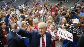 DALLAS, TX - SEPTEMBER 14:  Republican presidential candidate Donald Trump greets supporters during a campaign rally at the American Airlines Center on September 14, 2015 in Dallas, Texas. More than 20,000 tickets had been distributed for the event.  (Photo by Tom Pennington/Getty Images)