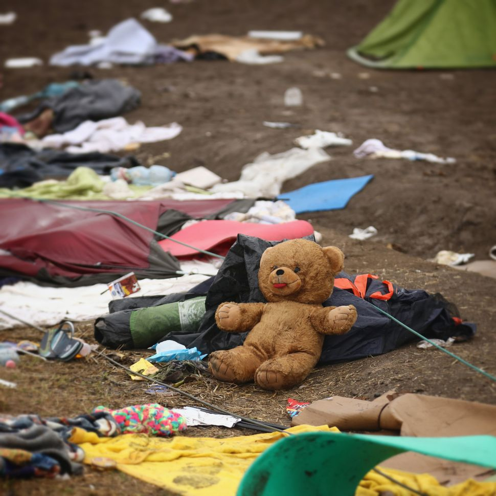 A teddy bear, tents and clothing.