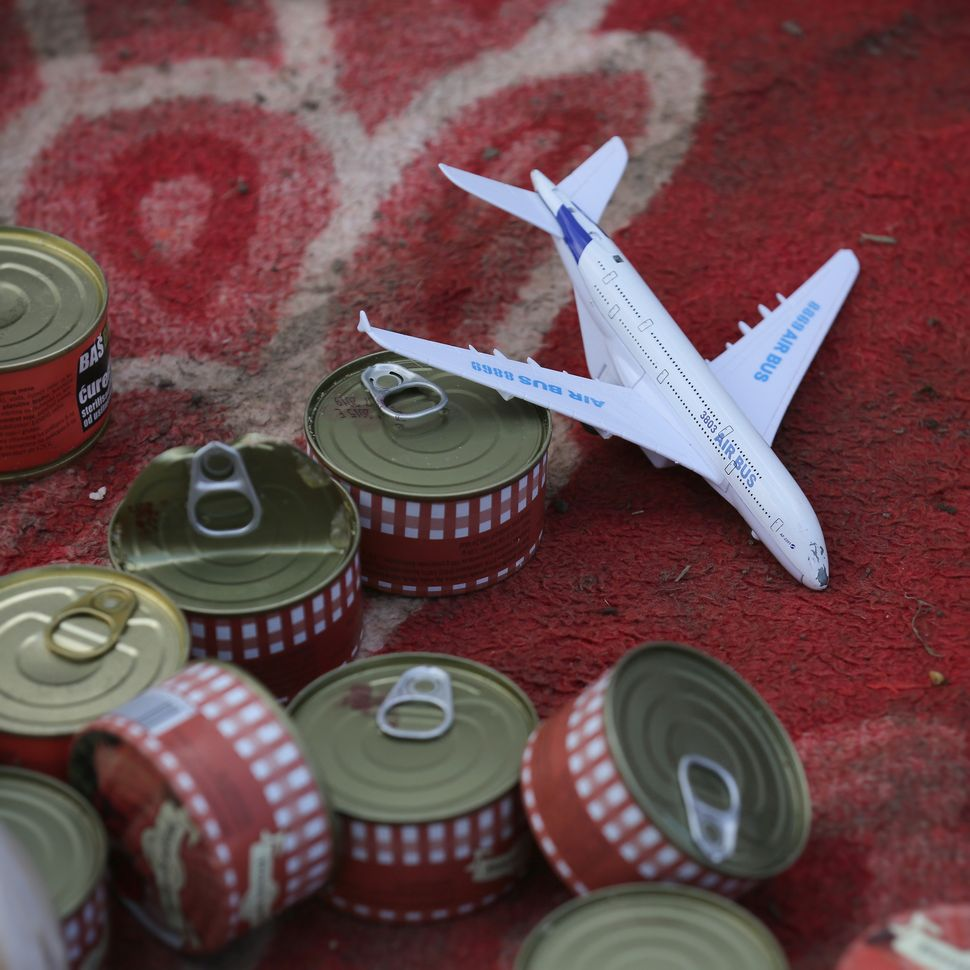 A toy aircraft and cans of food.