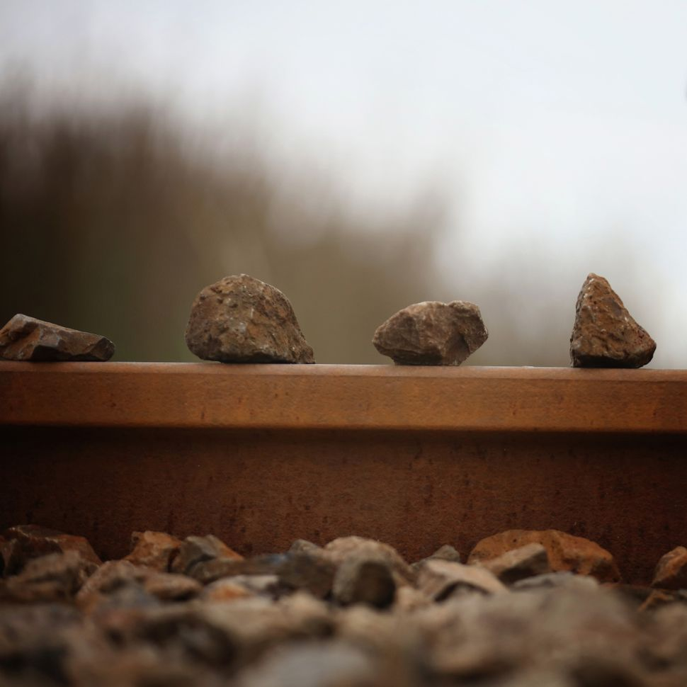 Rocks left behind on a railway track.