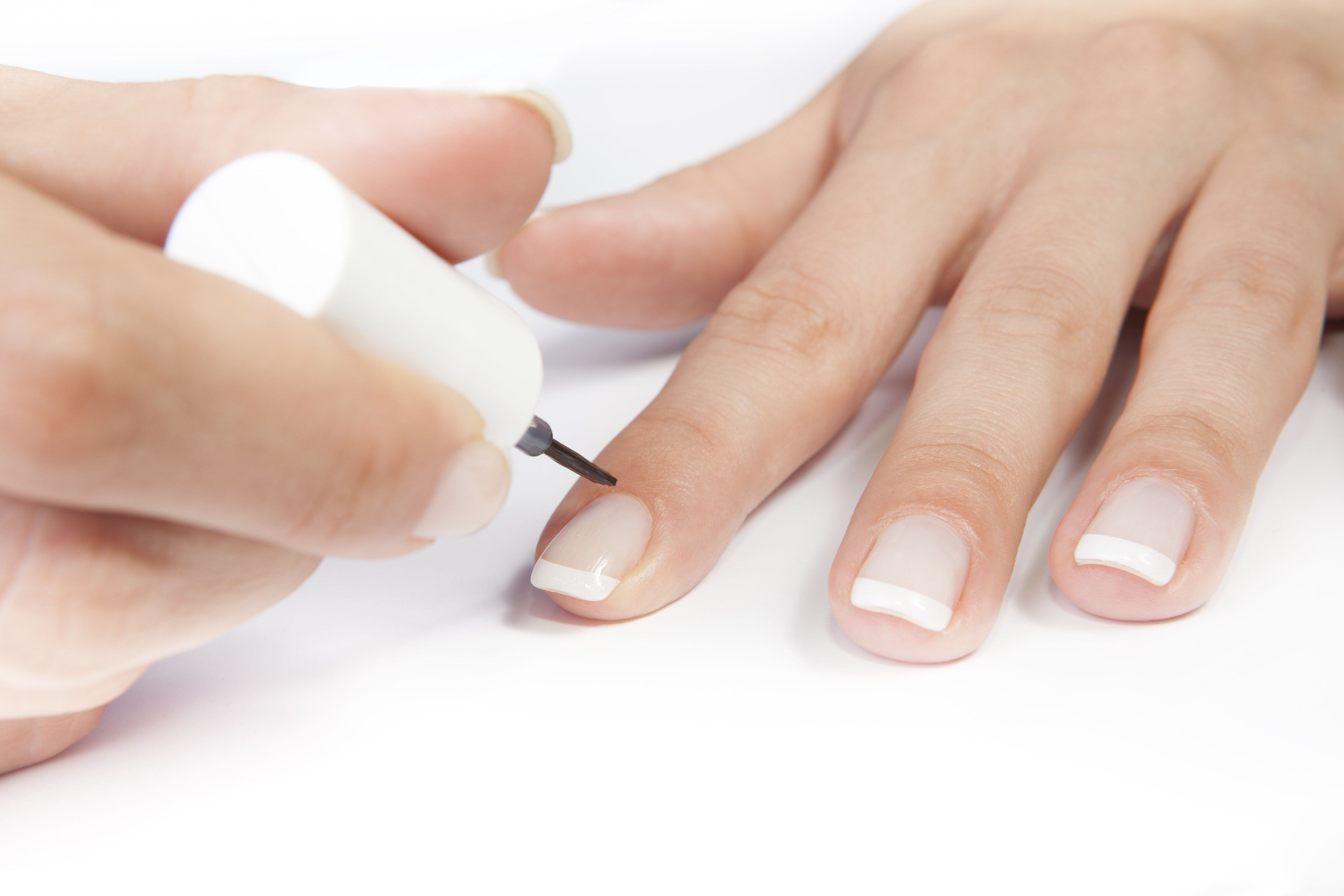 woman doing French manicure